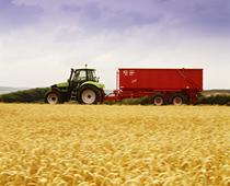 [Deutz-Fahr] trattore Agrotron 165 al lavoro con rimorchio