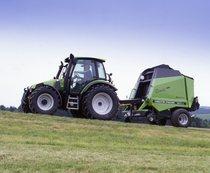 [Deutz-Fahr] trattore Agrotron 100 al lavoro con rotopressa
