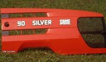 [Same] Trattore modello Silver 90 al lavoro con aratro e dettaglio del cofano