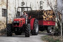 [SAME] trattore Argon 70 al lavoro con rimorchio carico di legna