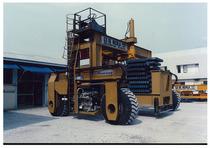 Motore ADIM per gru a cavalletto su gomma per la per la movimentazione di carichi ingombranti e pesanti