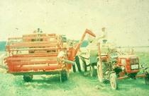 [Fahr] trattore D 180 H al lavoro con mietitrebbia